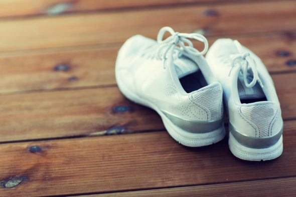 close up of sneakers on wooden floor